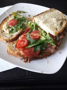 Porchetta/salami/mortadella/mozzarella sandwich with habanero salsa.